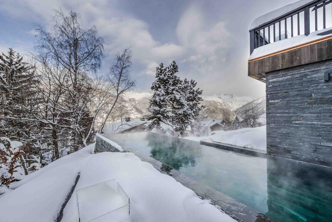 Kings-avenue-gourchevel-praz-ski-room-professional-kitchen-wine-cellar-home-cinema-half-exterior-swimming-pool-library-garage-area-gourchevel-praz-001-2