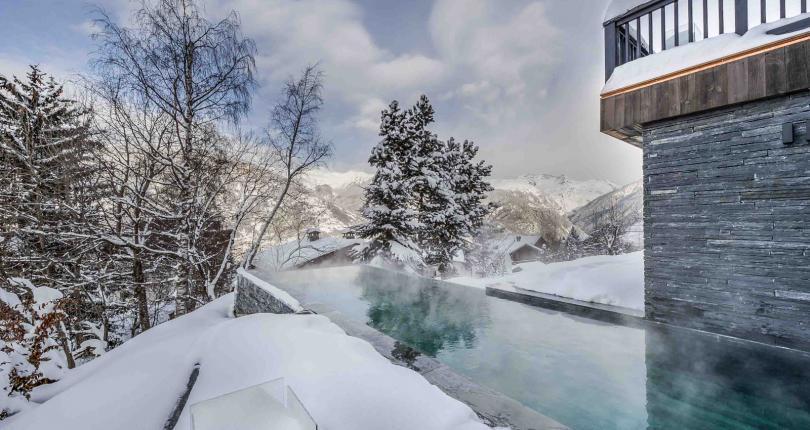 Kings-avenue-gourchevel-praz-ski-room-professional-kitchen-wine-cellar-home-cinema-half-exterior-swimming-pool-library-garage-area-gourchevel-praz-001-2