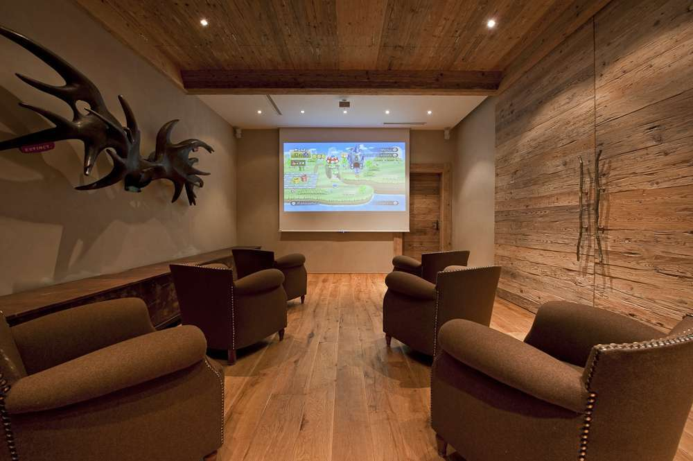 Kings-avenue-gstaad-indoor-jacuzzi-hammam-childfriendly-parking-cinema-kids-playroom-games-room-fireplace-area-gstaad-001-11
