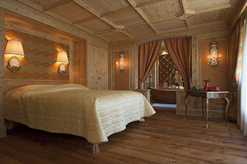 Kings-avenue-gstaad-indoor-jacuzzi-hammam-childfriendly-parking-cinema-kids-playroom-games-room-fireplace-area-gstaad-001-14