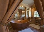 Kings-avenue-gstaad-indoor-jacuzzi-hammam-childfriendly-parking-cinema-kids-playroom-games-room-fireplace-area-gstaad-001-15