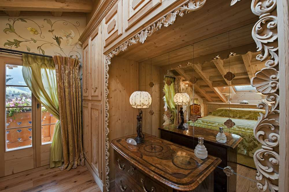 Kings-avenue-gstaad-indoor-jacuzzi-hammam-childfriendly-parking-cinema-kids-playroom-games-room-fireplace-area-gstaad-001-19