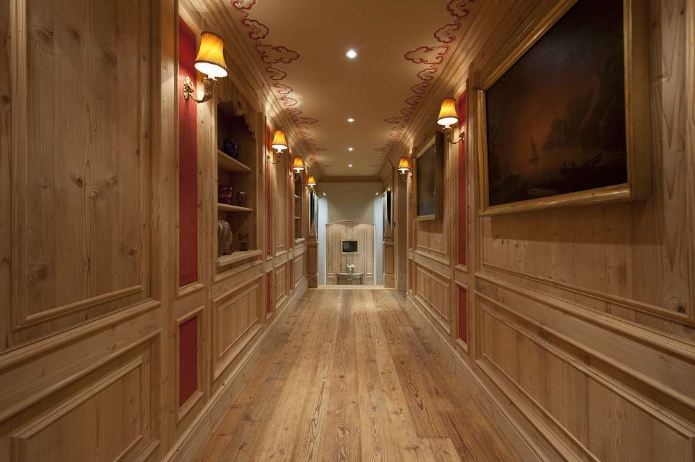 Kings-avenue-gstaad-indoor-jacuzzi-hammam-childfriendly-parking-cinema-kids-playroom-games-room-fireplace-area-gstaad-001-9