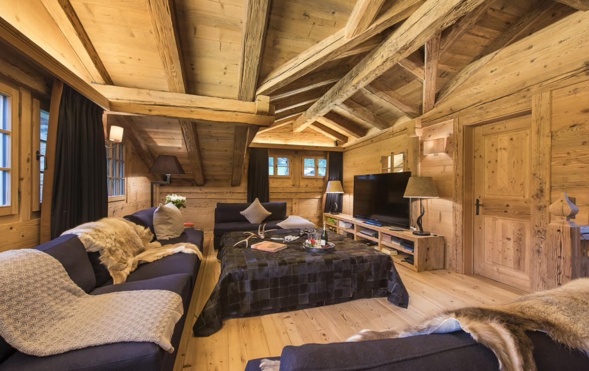 Kings-avenue-gstaad-sauna-hammam-childfriendly-parking-kids-playroom-games-room-gym-fireplace-cinema-plunge-pool-area-gstaad-004-14