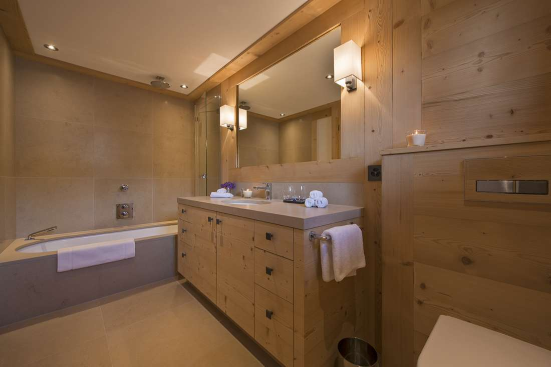 Kings-avenue-gstaad-sauna-jacuzzi-childfriendly-parking-cinema-gym-fireplace-gardens-area-gstaad-002-27