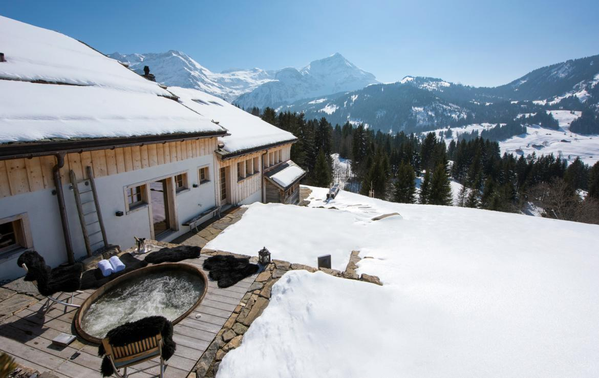 Kings-avenue-gstaad-sauna-outdoor-jacuzzi-covered-parking-cinema-gym-boot-heaters-fireplace-area-gstaad-002-4