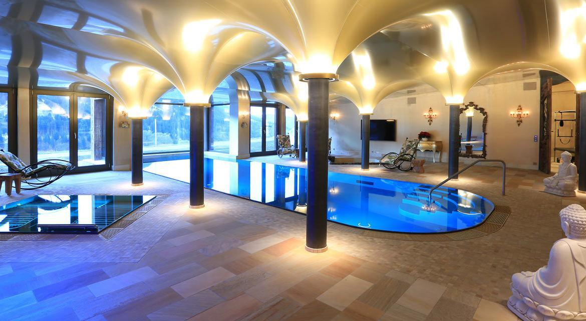 Kings-avenue-klosters-sauna-hammam-swimming-pool-parking-boot-heaters-fireplace-grand-piano-balconies-massage-room-cinema-kitchen-dining-room-area-klosters-002-21
