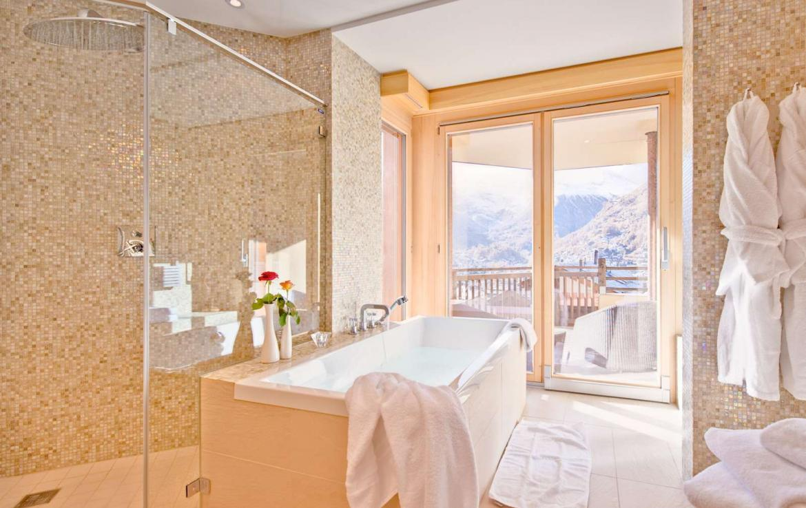 Kings-avenue-zermatt-wifi-sauna-jacuzzi-childfriendly-cinema-games-room-fireplace-pilates-yoga-room-balconies-area-zermatt-004-17
