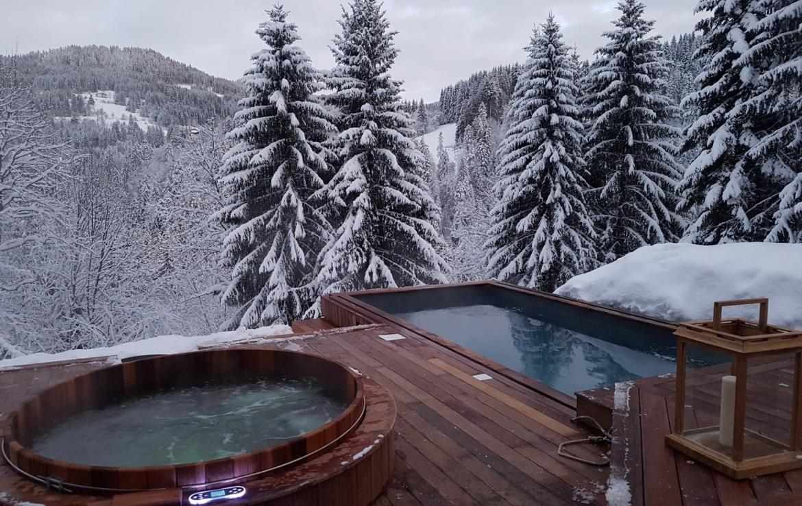 Wood deck luxury chalet with outdoor jacuzzi and outdoor pool les gets france