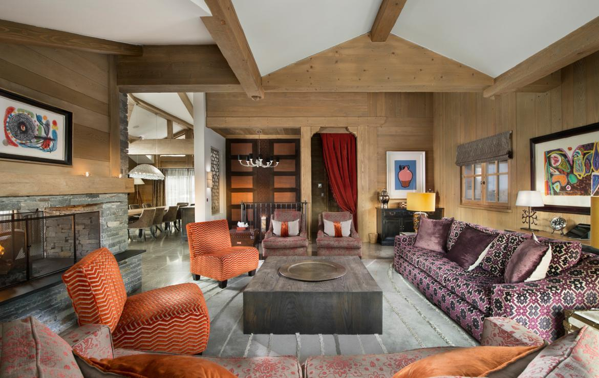 kings-avenue-luxury-chalet-courchevel-003-living-area-with-open-fireplace