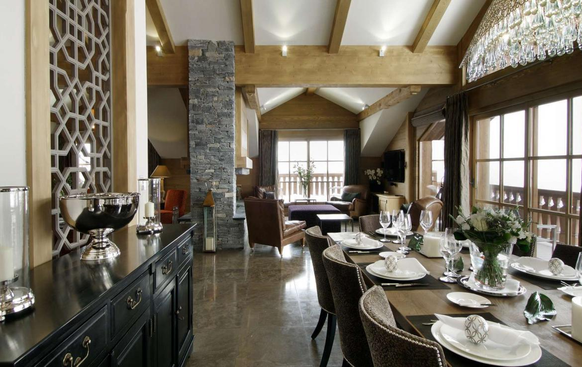 kings-avenue-luxury-chalet-courchevel-004-dining-table-with-relaxation-area-and-views