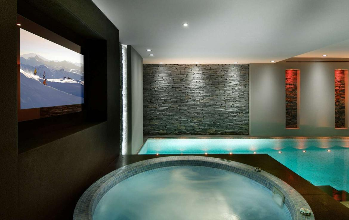 kings-avenue-luxury-chalet-courchevel-004-inside-swimming-pool-with-indoor-jacuzzi-hot-tub-and-tv