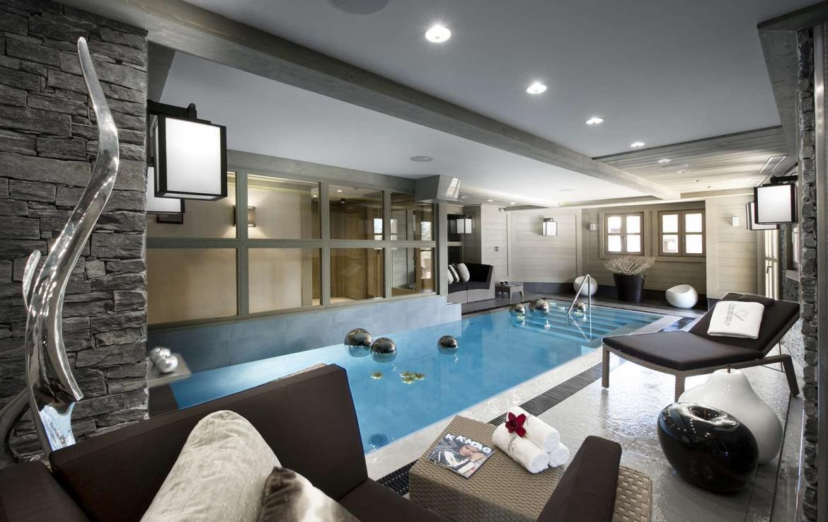 kings-avenue-luxury-chalet-courchevel-007-side-view-spa-area-with-indoor-swimming-pool