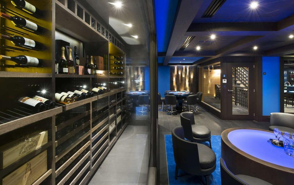 kings-avenue-luxury-chalet-courchevel-009-bar-area-with-wine-cellar
