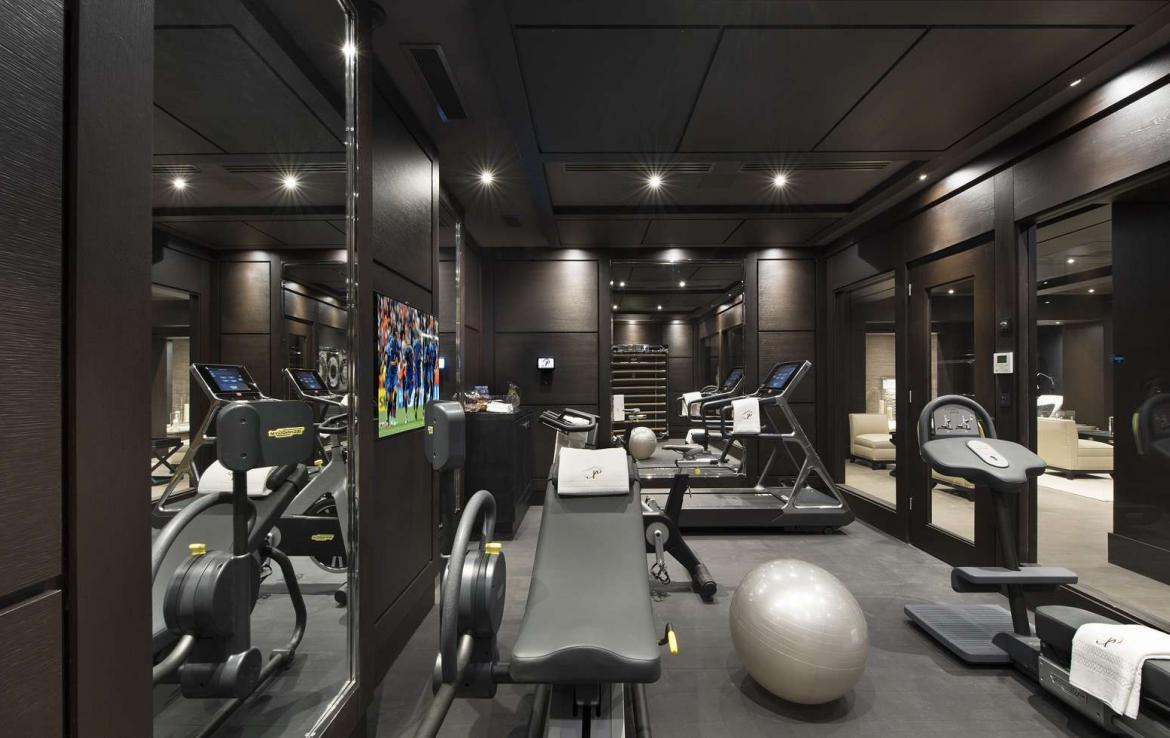 kings-avenue-luxury-chalet-courchevel-009-gym-with-tv