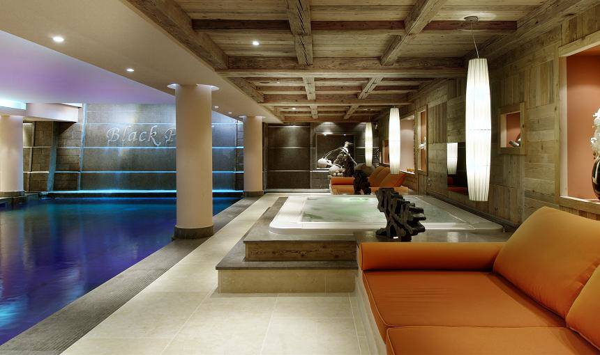 kings-avenue-luxury-chalet-courchevel-010-spa-area-with-indoor-swimming-pool-and-jacuzzi-hot-tub