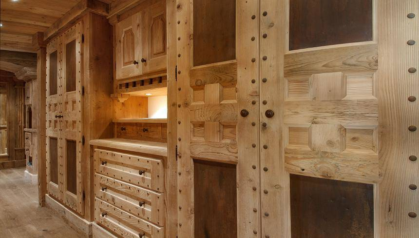 kings-avenue-luxury-chalet-courchevel-010-wooden-storage-cabinets