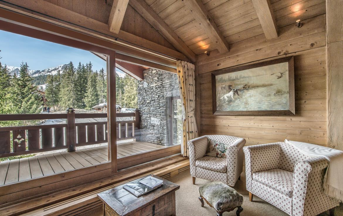 kings-avenue-luxury-chalet-courchevel-011-sitting-room-with-balcony-and-views
