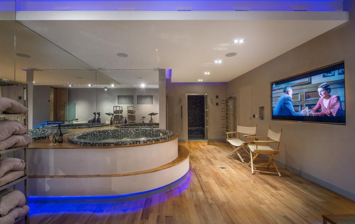 kings-avenue-luxury-chalet-courchevel-011-spa-area-with-indoor-jacuzzi-hot-tub-and-large-tv