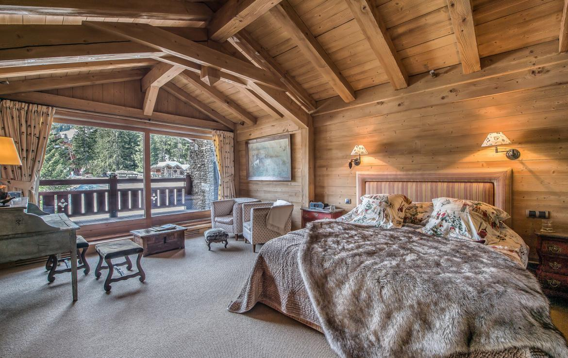 kings-avenue-luxury-chalet-courchevel-011-wooden-master-bedroom-with-balcony-and-views